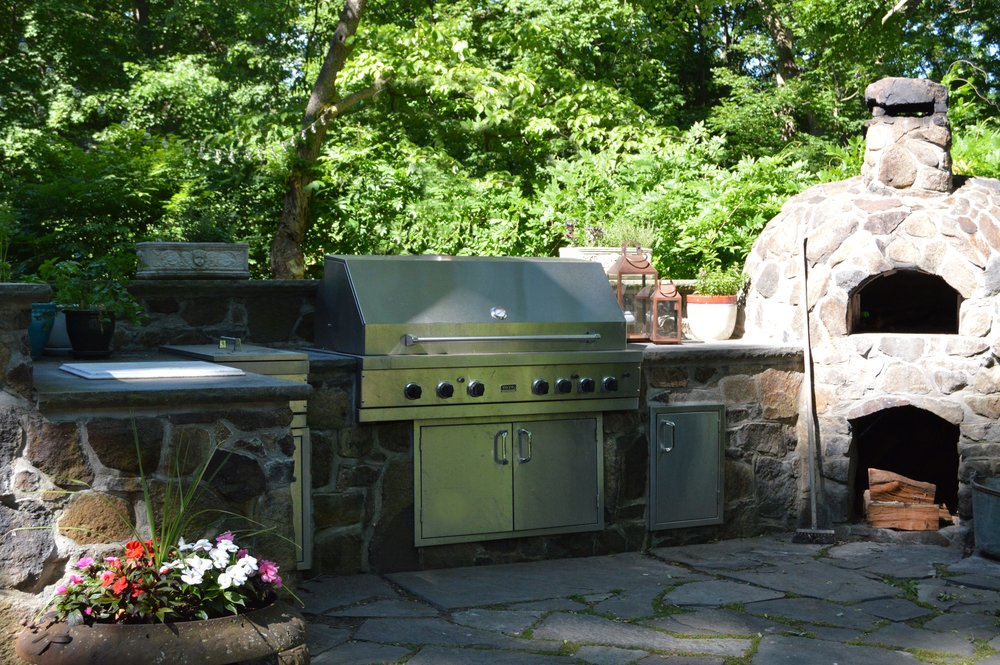 Professional landscape design with outdoor kitchen in Briarcliff Manor, NY