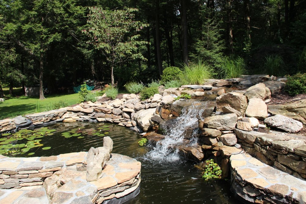 Professional landscape design with water feature in Briarcliff Manor, NY