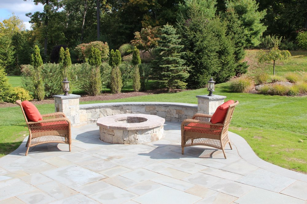 Professional landscape design with fire pit in Chappaqua, NY