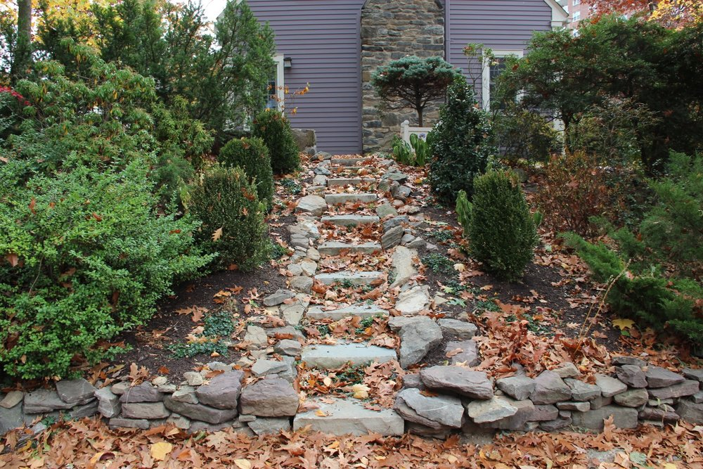 Top landscape design with stone steps in Millwood, NY