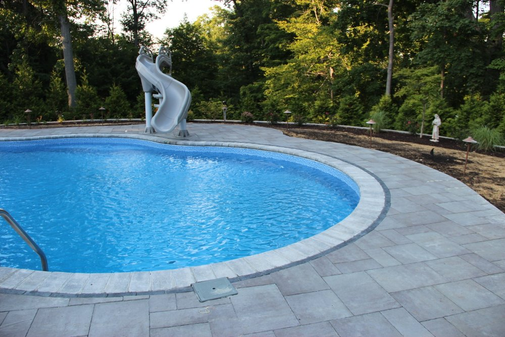 Top landscape design with pool deck in Armonk, NY