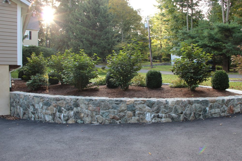 Professional landscape design with retaining wall in Chappaqua, NY