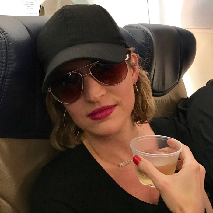 Yes, I was on a plane.  Yes, I was drinking wine.  Yes, I wear my sunglasses at night.