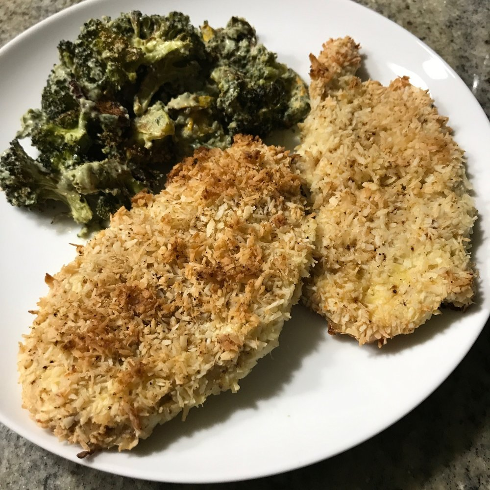 "Coconut crusted baked chicken and charred broccoli with tahini ""dressing""."