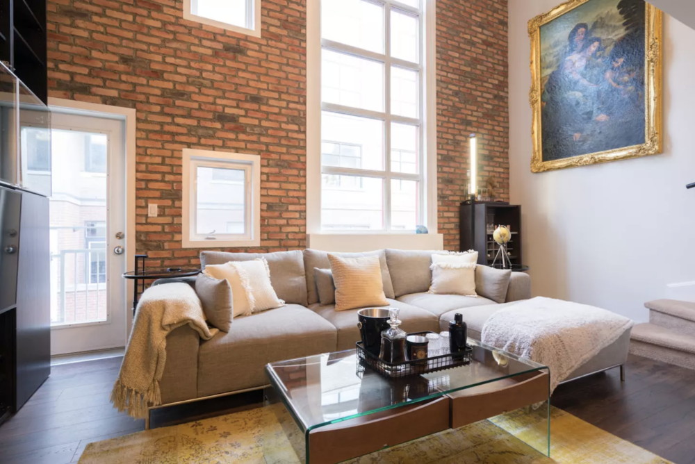 Luxe Executive Loft - Open and bright, this suite is well appointed reflecting the homeowners style. A modern look and feel, grand art paired with comfortable furnishings make you feel as though you have landed in the lap of luxury.Airbnb