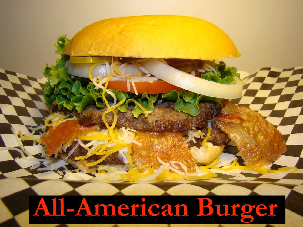 ALL-AMERICAN BURGER: A 1/3 Lbs,Homemade Beef Patty on a freshly baked toasted bun, CrispyBacon, Cheddar and Monterey Cheese, Pickles, Tomatoes, Onions, and Lettuce.