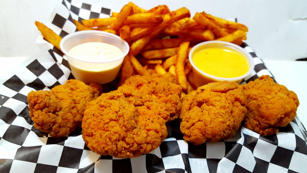 CHICKEN TENDER BASKET: Four Lightly Seasoned Chicken Tenders with Crispy Seasoned Battered Fries. Choice of Melted Queso, Jalapeño Ranch, or Ketchup.