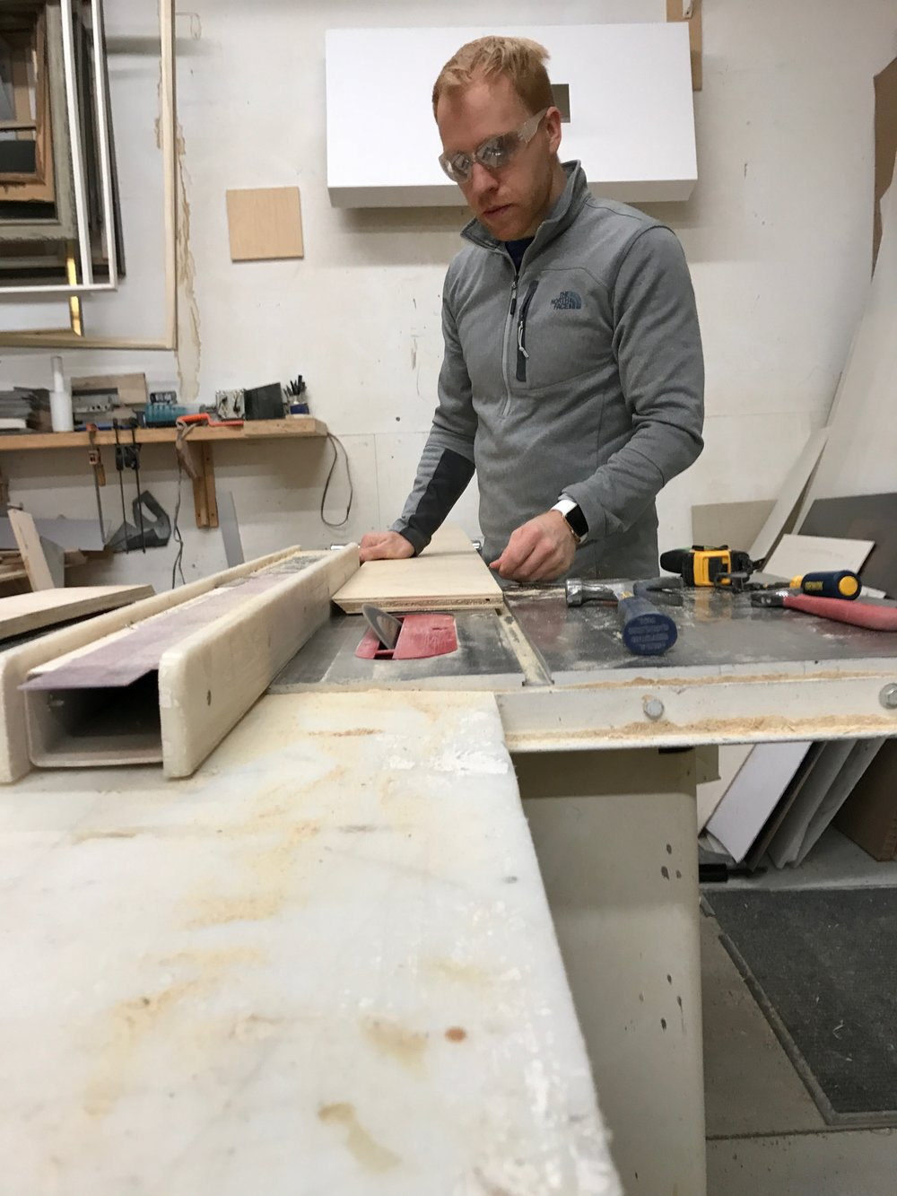 Wayne cuts angled trim boards for the control room interior.