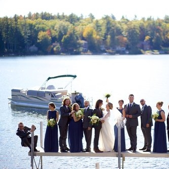 A blending of cultures and lifelong friends made this lake camp wedding extra festive.