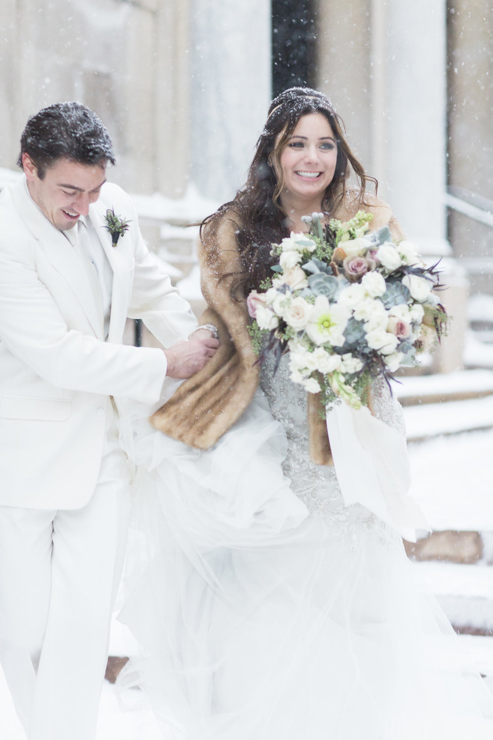 The bride wished for a winter wonderland on her wedding day, and Mother Nature kindly obliged.