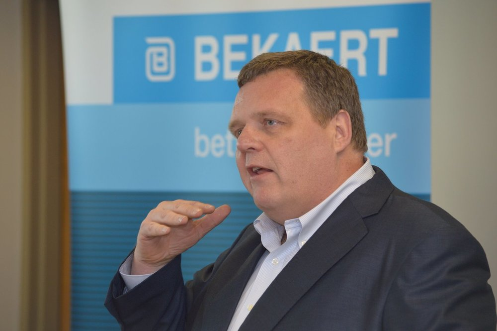 Bekaert CEO Matthew Taylor talks at a jobs announcement event today about the company's decision to expand in Rogers.
