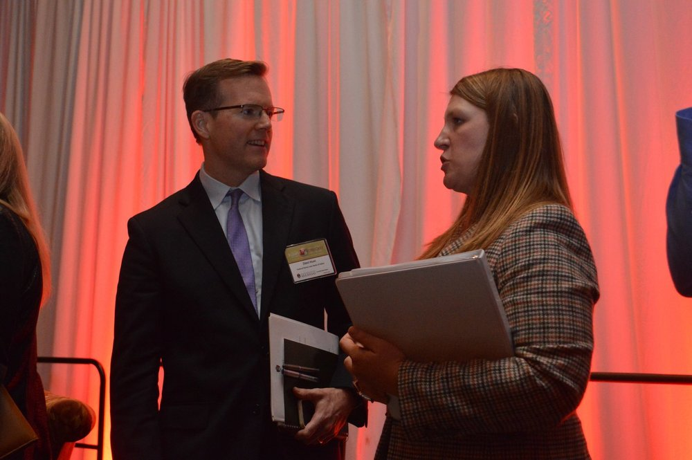 University of Arkansas economist Kathy Deck talks with Zimri Hunt of the Federal Home Loan Bank of Dallas after today's business forecast luncheon in Rogers.