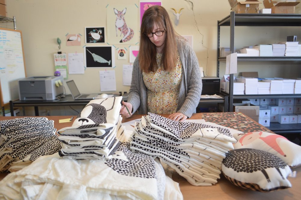 Stacie Bloomfield, the owner of Gingiber, opened her first and only storefront on Emma Avenue in Springdale this year. The majority of the working artist's greeting cards, calendars, tea towels, pillows and other products are sold online.
