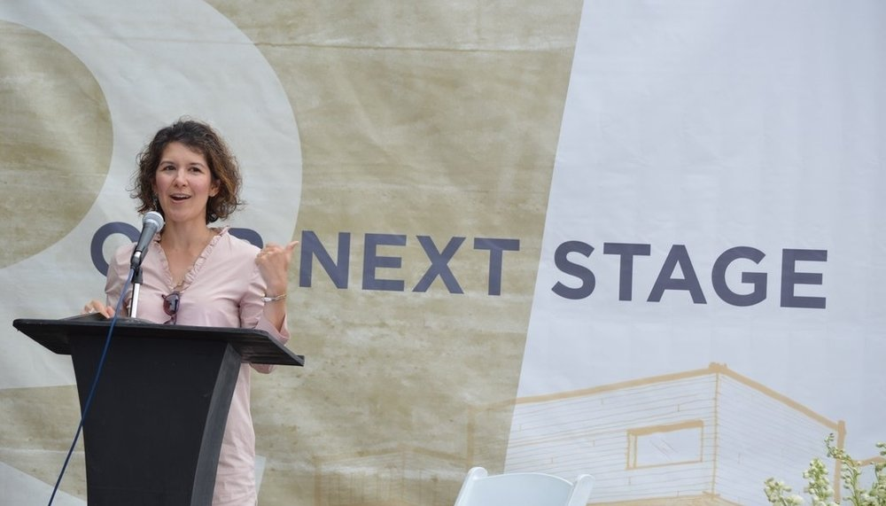 Karen Minkel of the Walton Family Foundation was among those who talked at Friday's groundbreaking ceremony about TheatreSquared, the region's only professional theatre company.