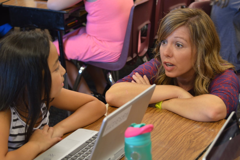 Teacher Darah Bennett talks with one of her students at Apple Glen Elementary School in Bentonville.