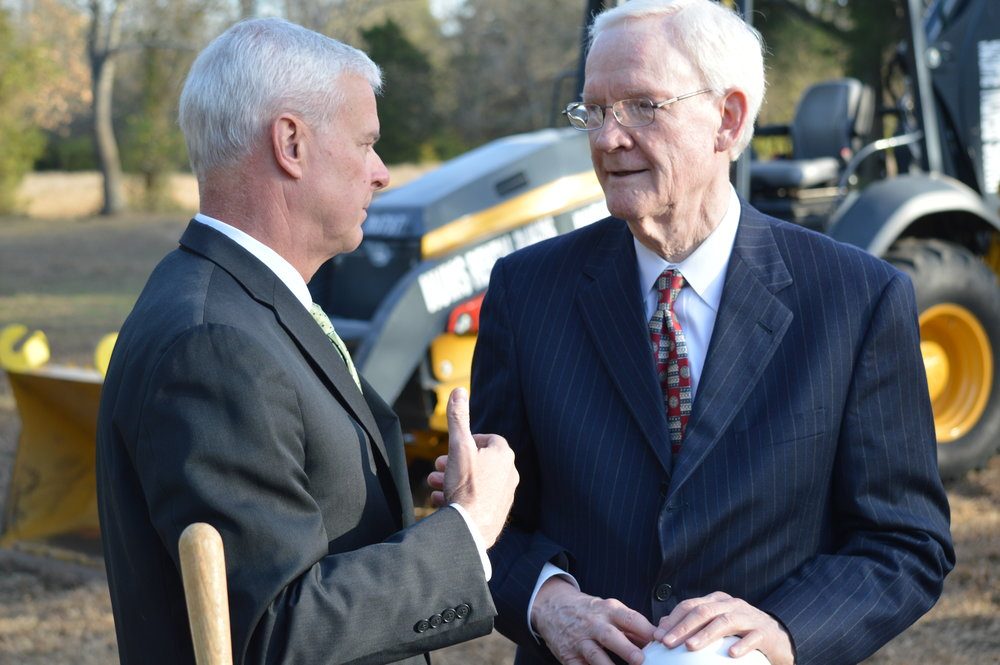 U.S. Rep. Steve Womack talks with OurPharma CEO Peter Kohler after a groundbreaking ceremony on Monday. Kohler's new company announced it will manufacture generic drugs in Northwest Arkansas, and construction on the company's new facility will start this winter.