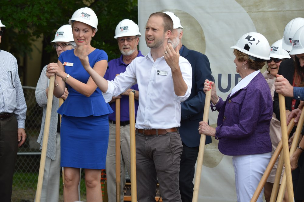 Martin Miller of TheatreSquared encourages the crowd to cheer during the groundbreaking ceremony for the professional theatre company's new facility in Fayetteville.