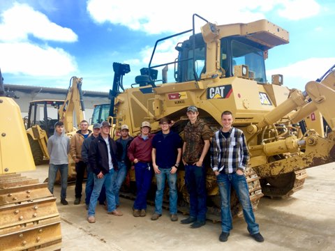 Workforce development programs at the Springdale School of Innovation and other schools are increasing skilled labor in Northwest Arkansas.The picture shows Springdale students on a field trip to learn more about diesel technology.