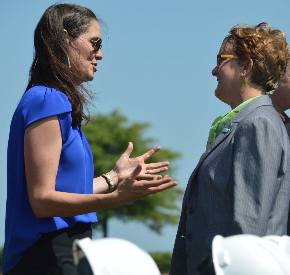 Erin Hogue of the Walmart Foundation talks with Northwest Arkansas Community College President Evelyn Jorgenson after today's groundbreaking ceremony. The Bentonville college is building an additional campus in Springdale.