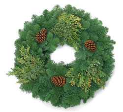 MIXED WREATH This beautiful wreath begins with a Noble Fir backdrop and adds cones and sprigs of cedar to finish off this festive addition to your front door.
