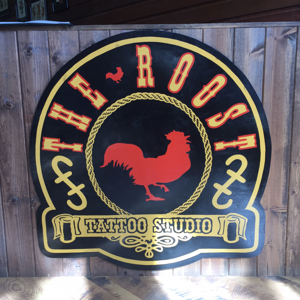 The Roost Tattoo Studio signage.