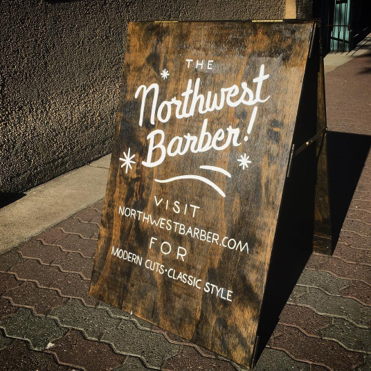 Hand-built sandwich board, free-handed lettering for The Northwest Barber.