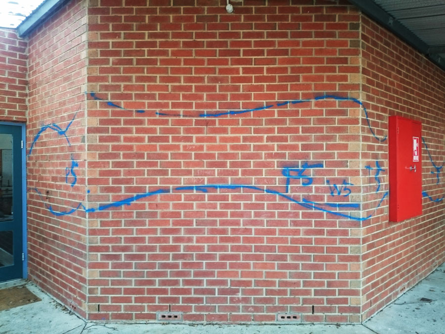 The wall with the very first drawing with blue spraypaint.