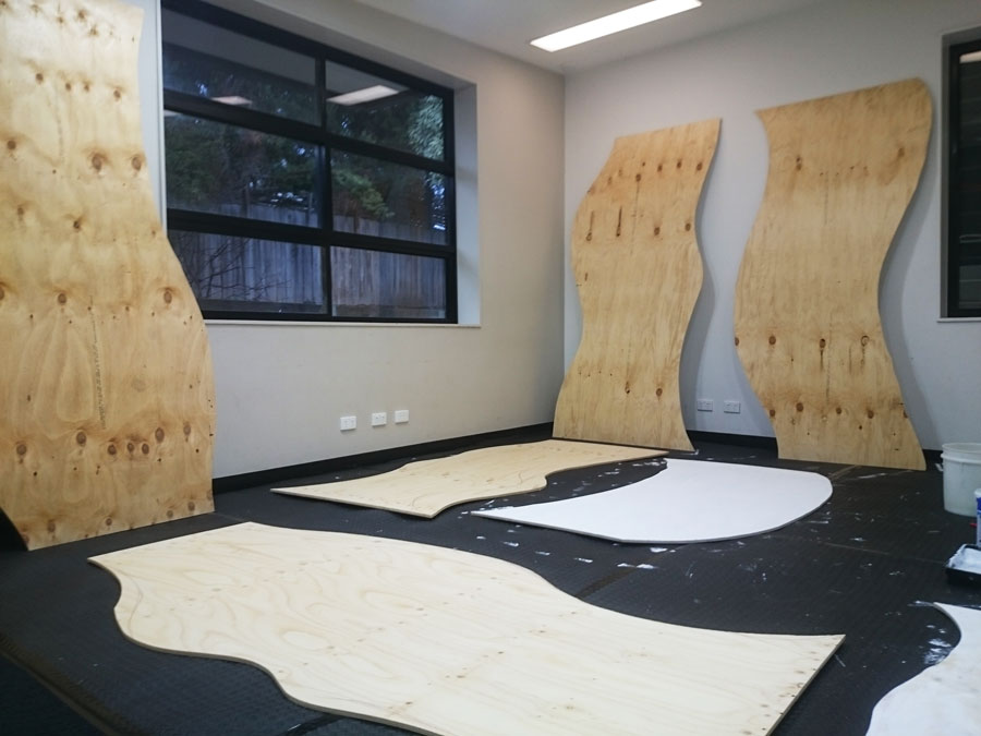 The wooden panels after I cut them and just started the undercoats.