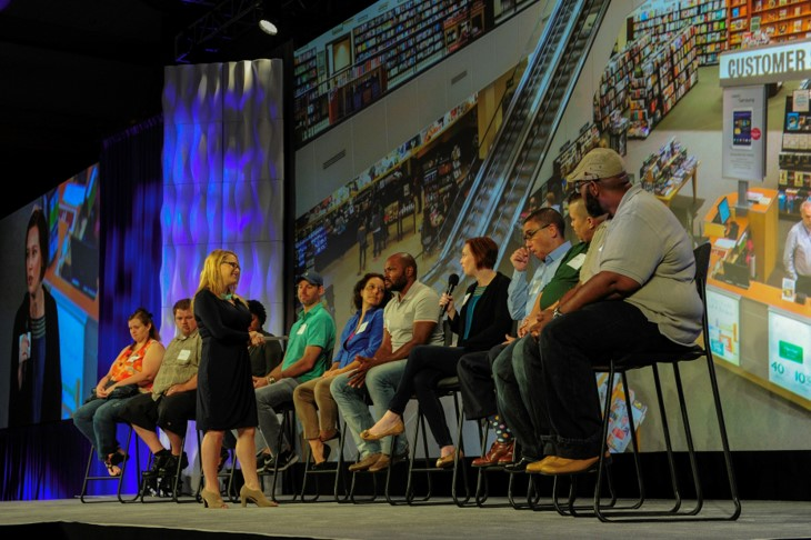 A panel of bookstore shopper in front of 800+ audience of store managers