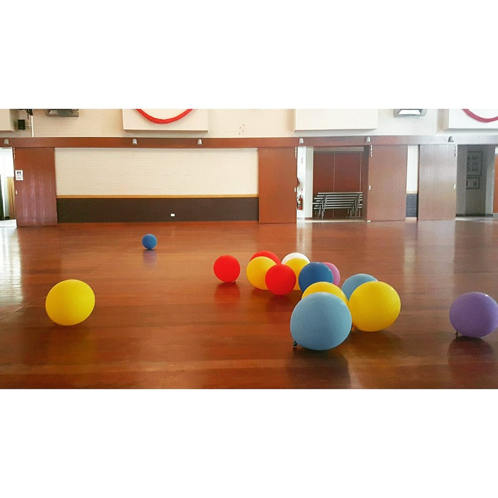This is the hall we worked in, which had lovely hardwood floors - perfect for hours of barefoot movement. The balloons are from a particularly hilarious movement activity, but were also used as a tool to help us explore the space, which is a key component of Dalcroze practice.