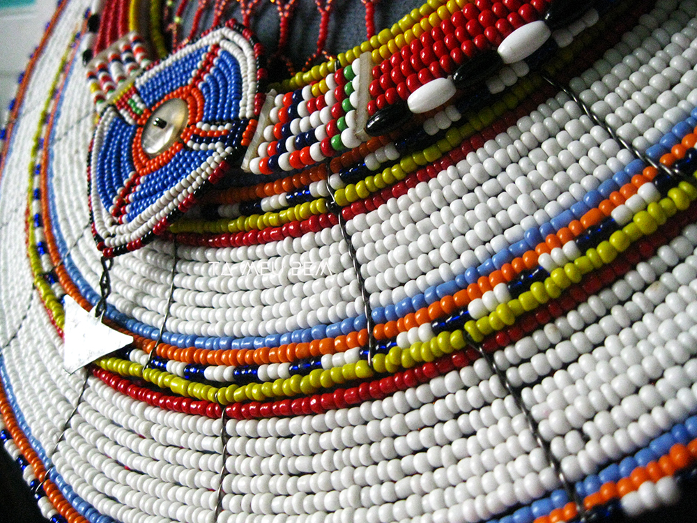 Close ups. These are two different necklaces with no identifying information on them. These necklaces aren't just ceremonial, but can also serve as village maps denoting status and position within the clan.