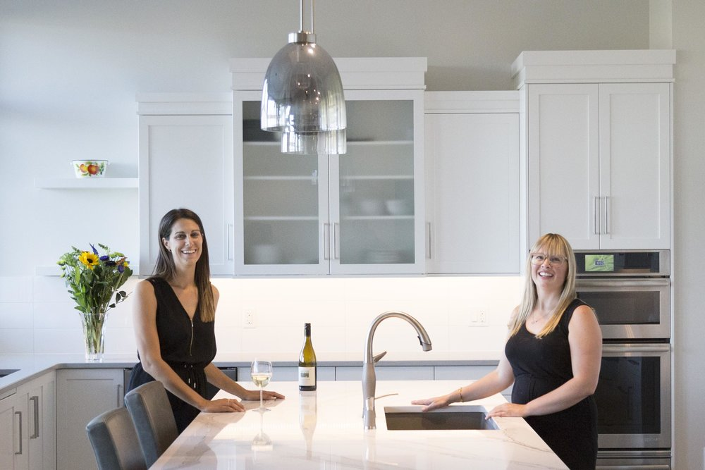 Maria and Heather enjoying a glass of wine in this modern kitchen