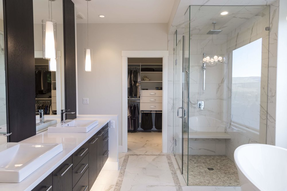 Master En-Suite marble title floors with pebble inlay