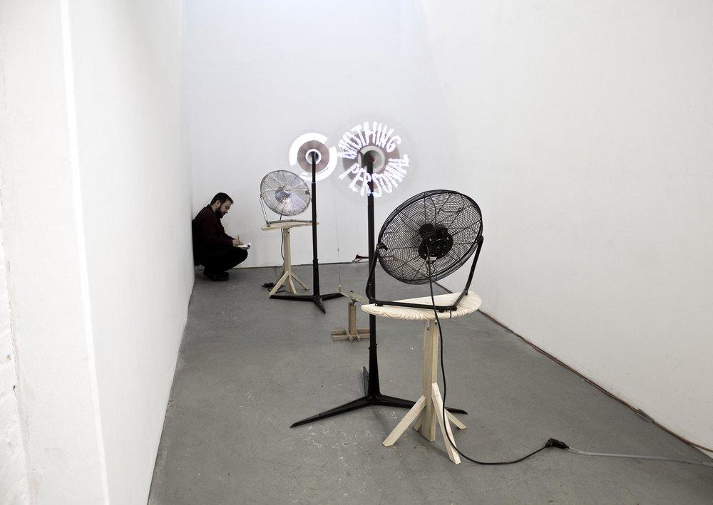 """Two Windmills"" , 2018 Windmill, fan, cymbal, fishing hook & wire, pendulum, 3'x 5'x 3'  Courtesy Kyungjin Kim &Carrie Able Gallery"