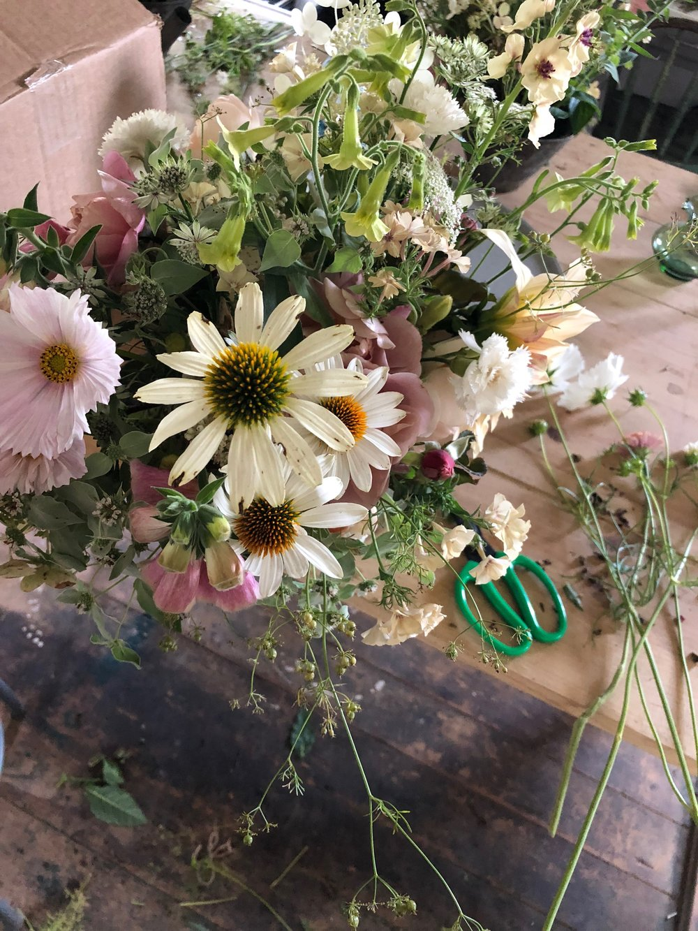 A creation using all the best flowers: Merton foxglove, coriander, white echinacea, 'distant drums' roses, 'starlight dancer' nicotiana, cupcake cosmos, astrantia…
