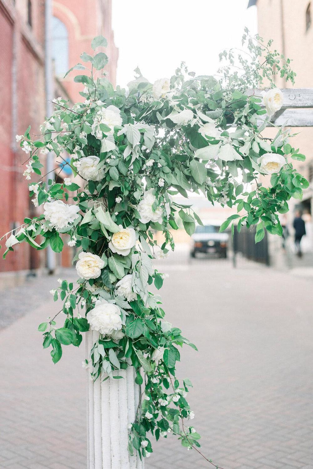Mock orange, Apple, Russian Olive and thorny and unpleasant (but pretty) multiflora rose made for a textured, beautiful display at this June wedding. Photo by Henry Photography.