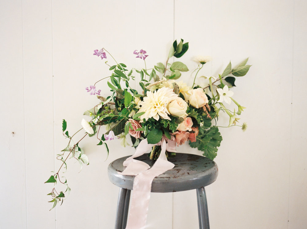 A bouquet of roses, dahlias, and rose geranium. Also containing apple foliage and 'Betty Corning' clematis - more on her below. Photo by Henry Photographs.