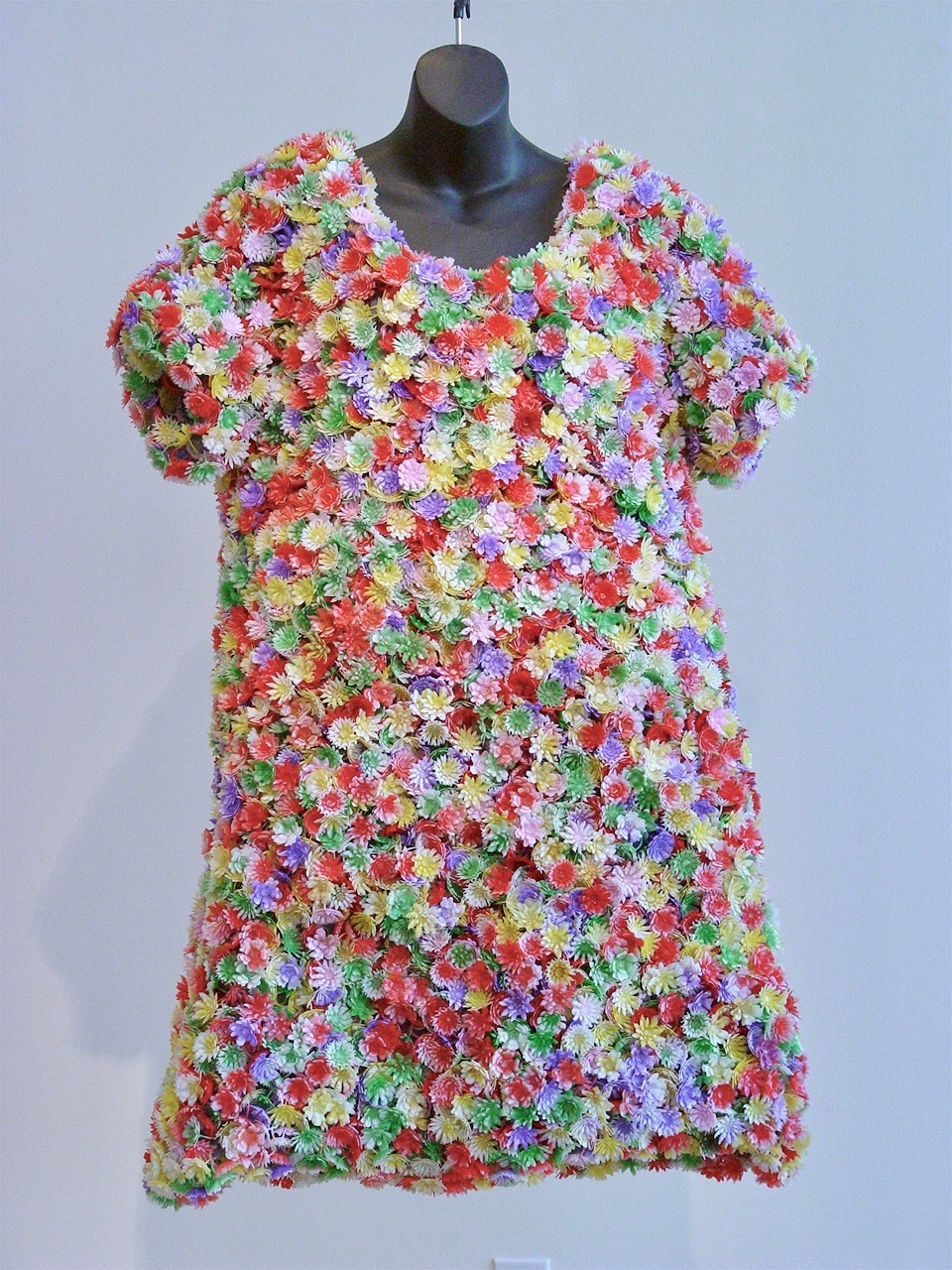 Garment for a Well Behaved Woman.   Plastic flower rings, thread, linen dress.