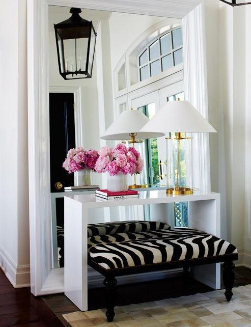 IMAGE VIA MY PINTEREST | Here we see a single lamp on an entryway table balance with flowers.