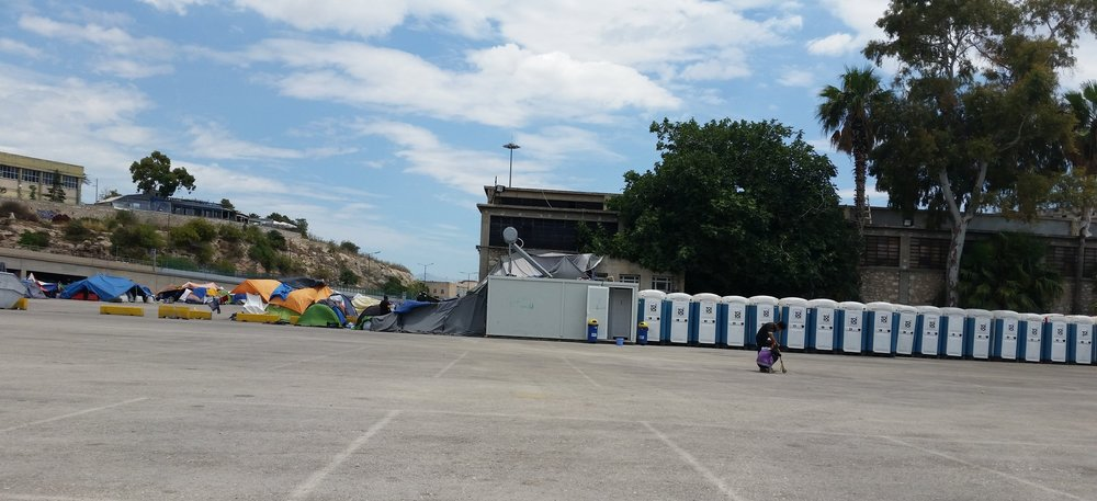 Port of Piraeus, June 2016. No running water. Portable toilets and shower house, next to tent camps.