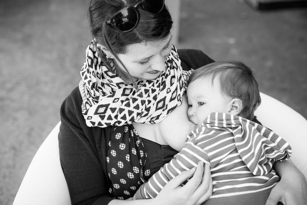 Mom breastfeeding son at Milkface Nursingwear