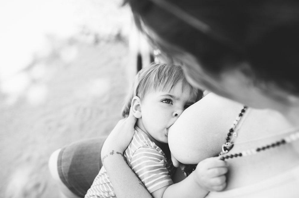 Baby boy breastfeeding Mala Rae at Ottawa Park outdoor session