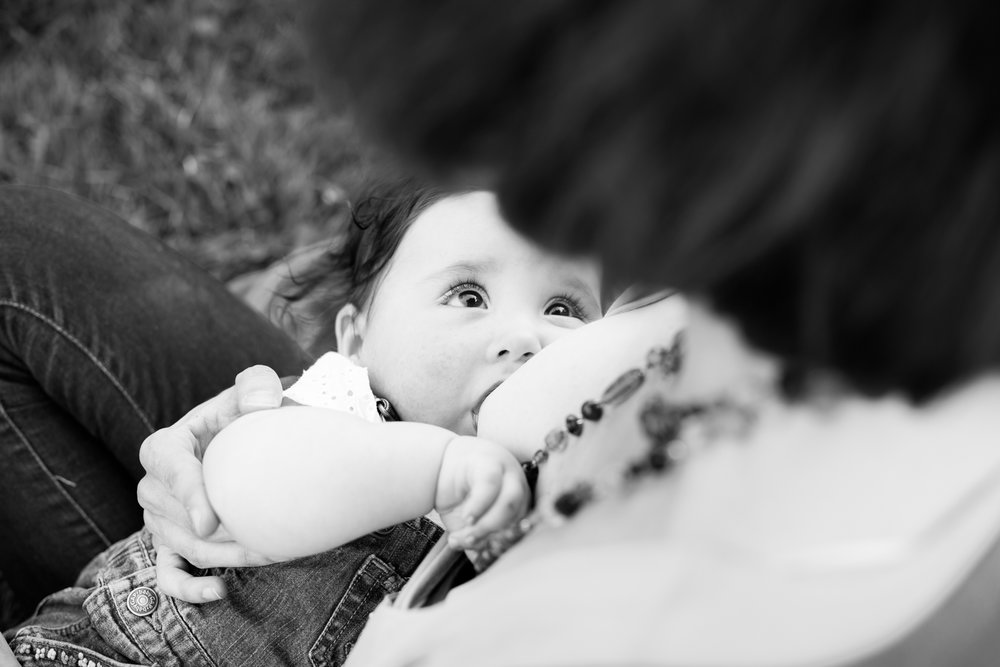 Breastfeeding baby and Mom at Arboretum Ottawa during photography session
