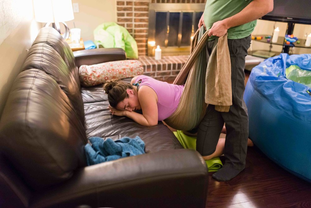 Husband supports Mom with wrap during homebirth with midwives