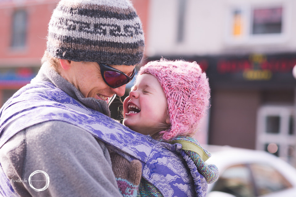 Dad babywearing daughter laughing in Byward Market Oscha Wrap