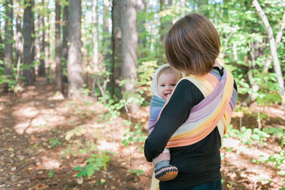 Girasol woven wrap Mom cuddles baby girl at Mer Bleu