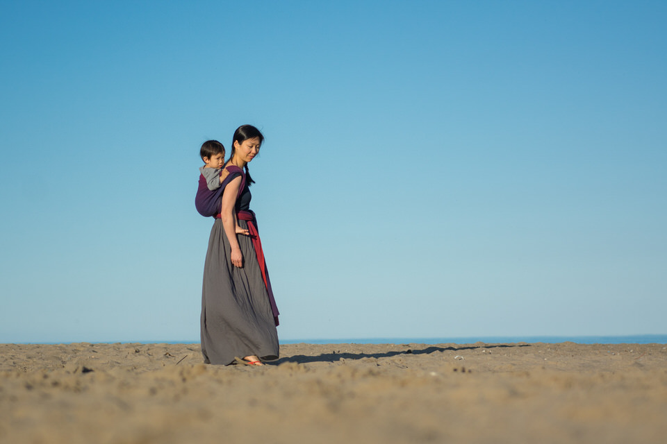 Babywearing Mom and son in handwoven wrap on beach