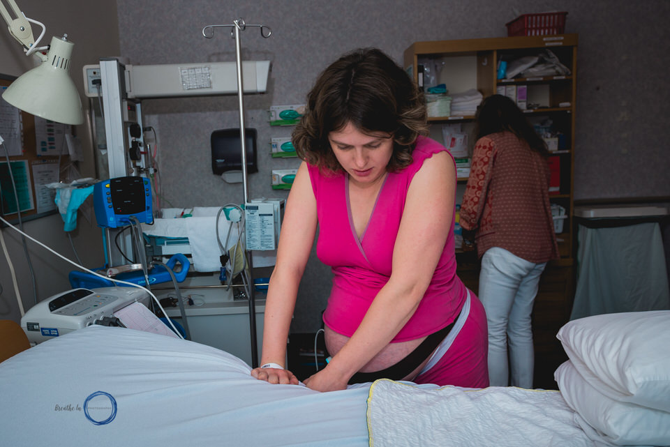 Woman in labour at Almonte Birth Centre sways hips to manage contractions.