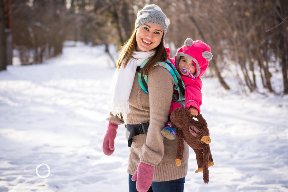 Beautiful mom and baby babywearing in the winter in Vanier Sugar Bush.