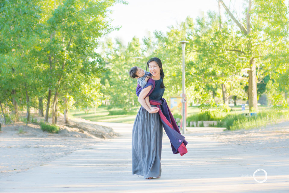Babywearing photo for beach mini sessions with Breathe In Photography.